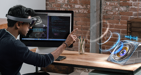 Man interacting with Microsoft HoloLens