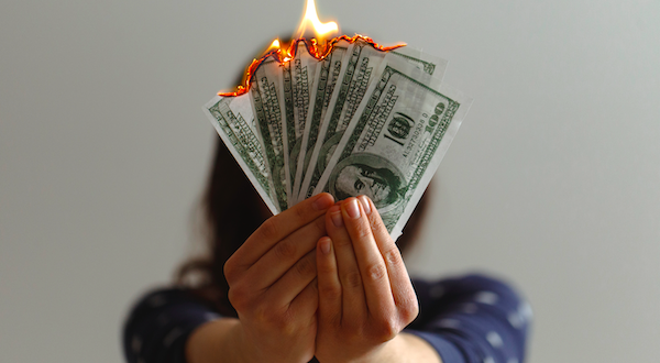 setting cash on fire image